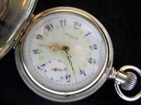 6 size Elgin, 15 jewel with a silver case and multi-colored dial