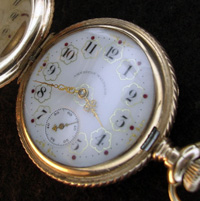 Waltham pocket watch with multi-colored dial filagree hands hunters case